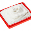 Stock Photo: Sour cream in red small square plate