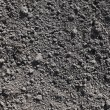 Cultivated gray dried soil, nature background — Stock Photo