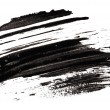 Stroke (sample) of black mascara, isolated on white macro — Stock Photo #5532042