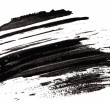 Stroke (sample) of black mascara, isolated on white macro — Stock Photo