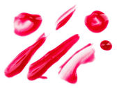Red fluid lips gloss samples, isolated on white — Stock Photo