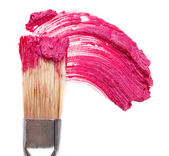 Pink lipstick stroke (sample) with makeup brush, isolated on whi — Stock Photo