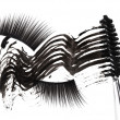 Постер, плакат: Black mascara stroke brush and false eyelashes abstract composi