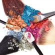 composition with makeup brushes and broken multicolor eye shadow — Stock Photo