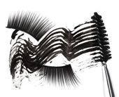 Black mascara stroke, brush and false eyelashes abstract composi — Stock Photo
