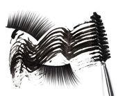 Black mascara stroke, brush and false eyelashes abstract composi — Stock Photo