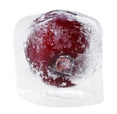 Red sweet cherry inside of melting ice cube, isolated on white — Stock Photo