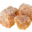 Three brown lump cane sugar cubes, isolated on white - Stock Photo