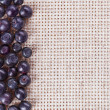 Stock Photo: Many bilberry fruits, on gray linen table cloth with copy space