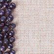 Many bilberry fruits, on gray linen table cloth with copy space — Stock Photo