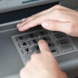 Entering atm cash machine pin code — Stock Photo #5937566