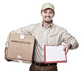 Smiling delivery man — Stock Photo