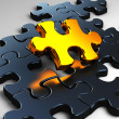 Golden jigsaw - Stock Photo