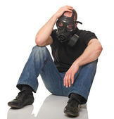Stressed man with gas mask — Stock Photo