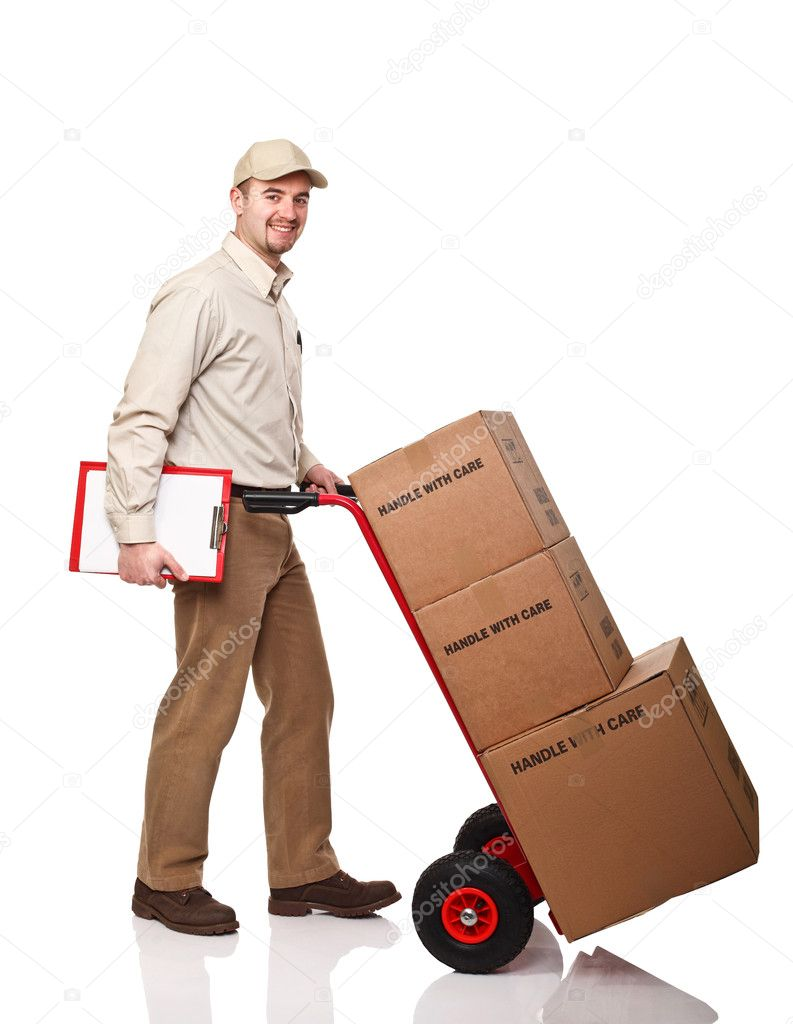 Smiling delivery man with red handtruck on white background — Stock Photo #5610237