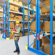 Woman in warehouse — Stock Photo