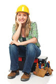 Woman on toolbox — Stock Photo