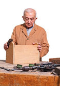 Old carpenter — Stock Photo