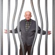 Old man in prison - Stock Photo