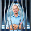Calm man in prison - Stock Photo