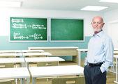 Senior teacher at school — Stock Photo