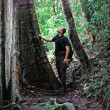 Man in borneo jungle — Stock Photo