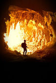 Woman in cave — Stock Photo