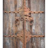 Antique Wooden Door with Bronze Fittings — Stock Photo