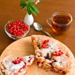 Cake, tea, red currant and lupine - Stock Photo