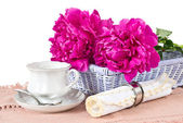 Cup, napkin and peonies — Stock Photo