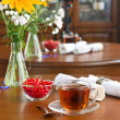 Glass tea cup on wooden table — Stock Photo