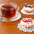 A cup of tea and two cake — Stok fotoğraf