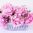 Stock Photo: Basket of pink peonies