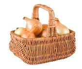 Fresh onions in basket — Stock Photo
