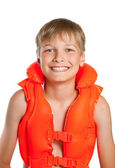 Teen in an orange life jacket for water sports - on a white back — Stock Photo