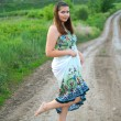 Girl in light dress on the road — Stock Photo