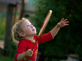 Girl plays with a racket in badminton — Stock Photo