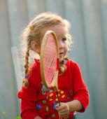 Girl plays in badminton — Stock Photo