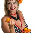 Royalty-Free Stock Photo: Woman in bathing suit with apricots