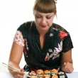 Woman eating rolls - Stock Photo