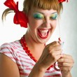 Laughing girl with striped candy - Stock Photo