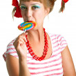Girl with plaits biting lollipop — Stock Photo #6248636