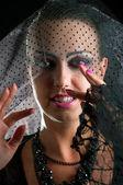 Joven bruja en un velo evoca — Foto de Stock