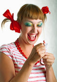 Laughing girl with striped candy — Stock Photo