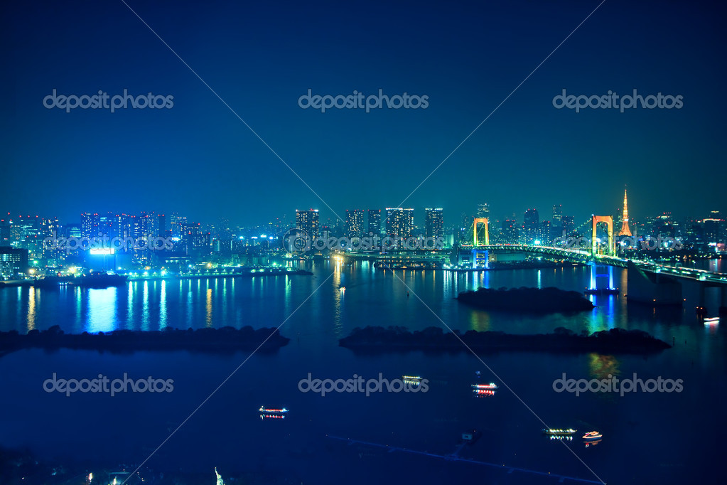 The landscape of Rainbow Bridge and the city which are night at a tourist spot in Tokyo — Stock Photo #5429021