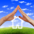 House in the hands against the blue sky — Stock Photo #5425382