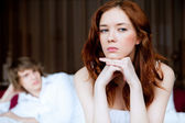 Couple in disagreement in bedroom — Stok fotoğraf
