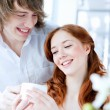 Young couple with a gift — Stock Photo