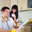 Young couple at breakfast — Stock Photo #5470646