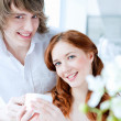 Young couple with a gift — Stock Photo #5543856